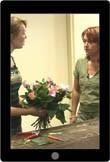 Medewerkers in de bloemenwinkel instrueren